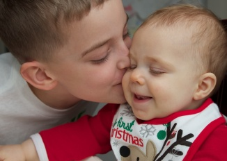 Big Brother gives Baby Si a love on Christmas Day