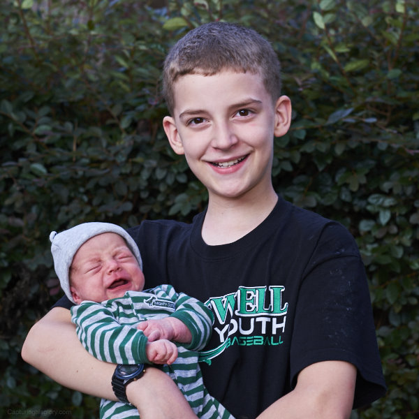 Kalen holds John Paul on this 12th birthday today!